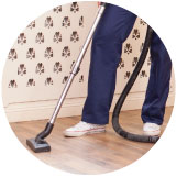 floor-level image of person vacuuming