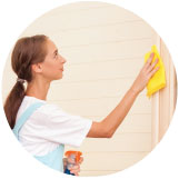 image of woman cleaning a wall
